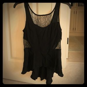Top with lace cutouts. Low-high, relaxed peplum