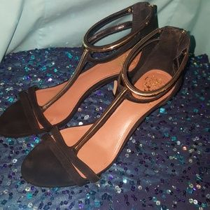 Vince Camuto black and gold open toe high hills.