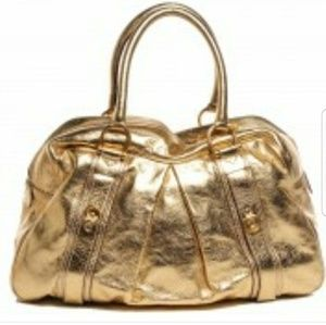 Authentic Burberry Ashbury gold leather handbag.