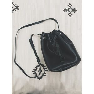 Black Faux Leather Bucket Bag with Green Interior