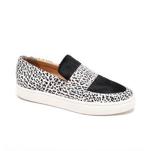 Black and white spotted slip-on sneakers