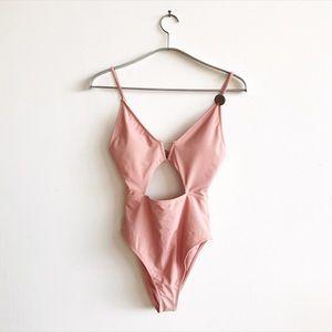 High hip swimmy in a nude pink. Unworn.