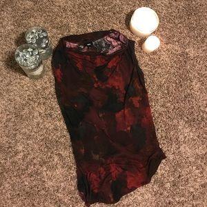 Black and burgundy red splatter design shirt.