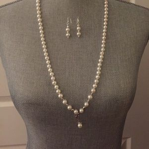 Long pearl necklace and earrings set.