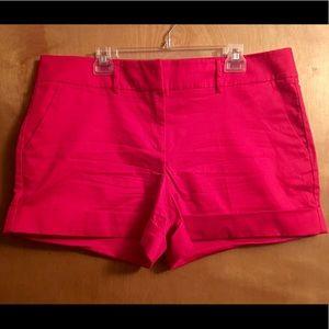 Women's magenta dress shorts.
