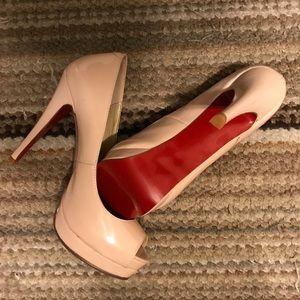 Blush pink open toe pumps