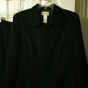 Size 12 black jacket and skirt 100% polyester