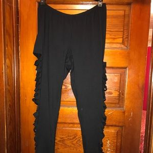 Torrid black leggings with side slashes. Brand new