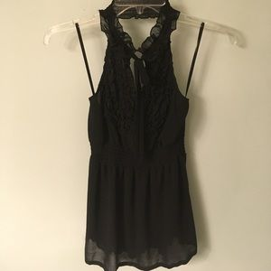 Black halter with ruffle detail at the neck