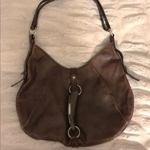 Well-loved Yvette Saint Laurent handbag