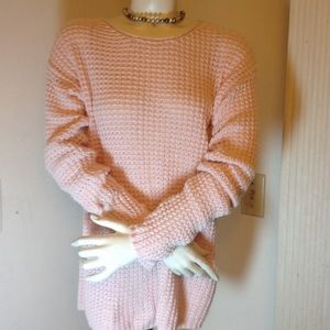 Pink sweaters with bows in the back