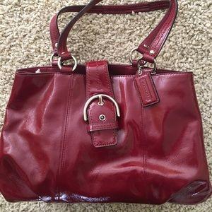 Red paten leather coach handbag