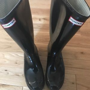 Well used Hunter Boot black size 8
