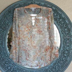 CAbi l/s silk tunic.Embellished neckline. Size M