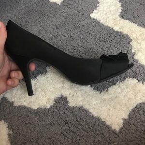 Black satin peep toe heels with ruffle detail
