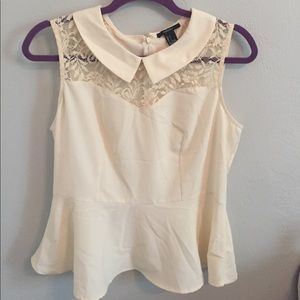 Cream peplum with lace detail