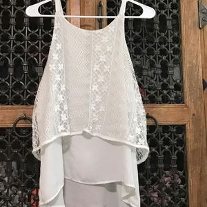 A white top with zig zag, and flower lace