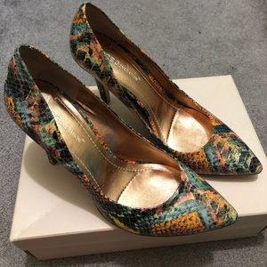 BCBGeneration snakeskin pump heels