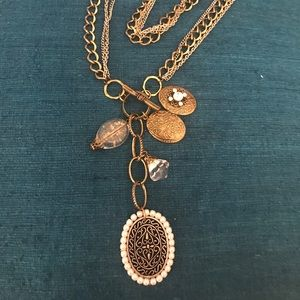 Three chain necklace with locket & beaded pendants