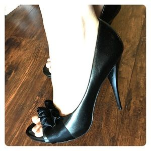 Black Carlos peep-toe pumps with ruffle