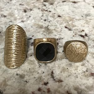 Trio golden rings with black crystal