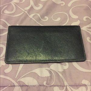 Coach black leather check book