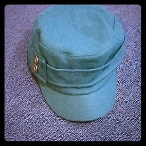 Teal cap with gold buttons. NWOT