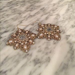 Dangling gold earrings