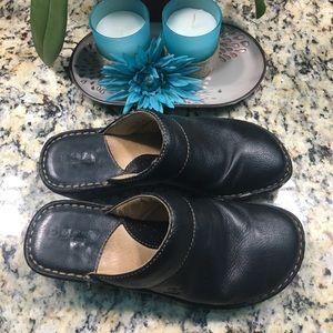 Born black leather clogs