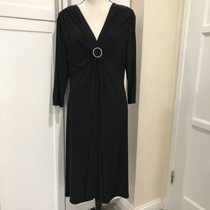 Beautiful black dress with rhynstone pin in front