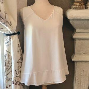 Banana Republic cream sleeveless blouse
