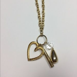 Long gold costume necklace with whistle