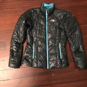 Teal down jacket by North Face. Size XS.