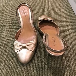 Gold sling back pumps with beautiful bow