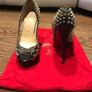 gold  and black spiked christian louboutin