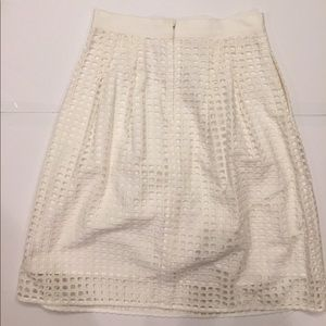 White skirt with cutouts