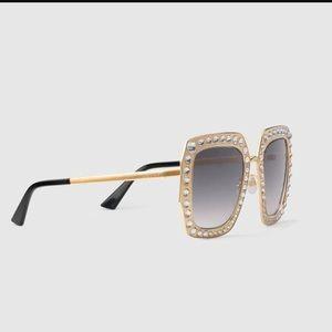 Gucci GG 0115s gold sunglasses
