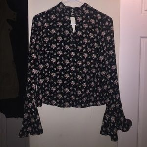 Black long sleeve top with floral print