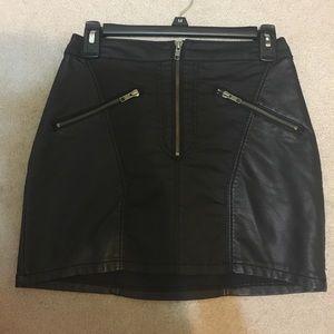 2 black mini skirts