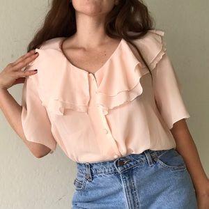 Peach ruffled blouse