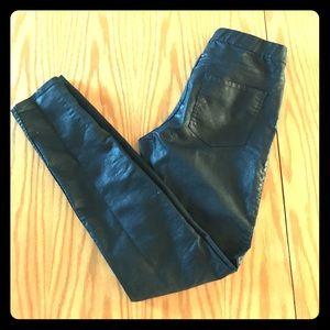 Shiny black trousers