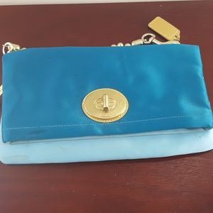 Turquoise satin Coach clutch with gold detailing