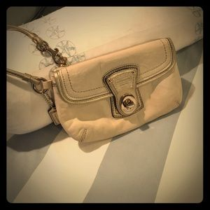 Coach tan and gold two pocket wristlet