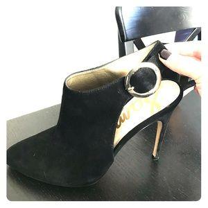 Black sling back heels with gold buckle