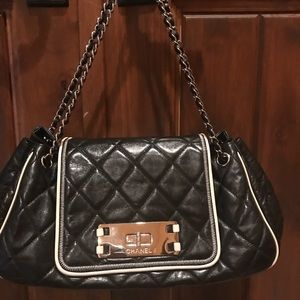 Chanel black and white quilted handbag.