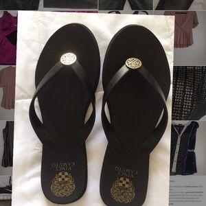 rubber flip flops, black with gold detailing
