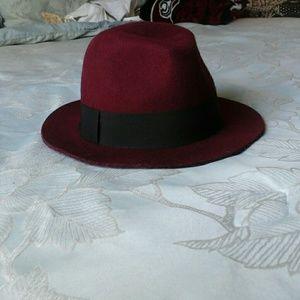 A burgundy fedora hat