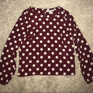 Long sleeved polka dot blouse