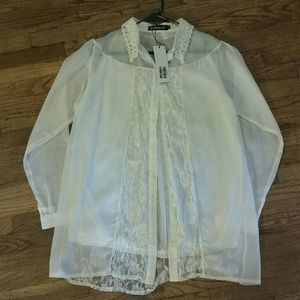 Lacey white long sleeved blouse