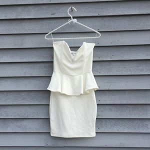 White Strapless Deep V Peplum Body con Dress